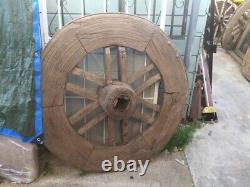Antique Indian Ox cart wagon wheel. Large, heavy wood/ metal rim